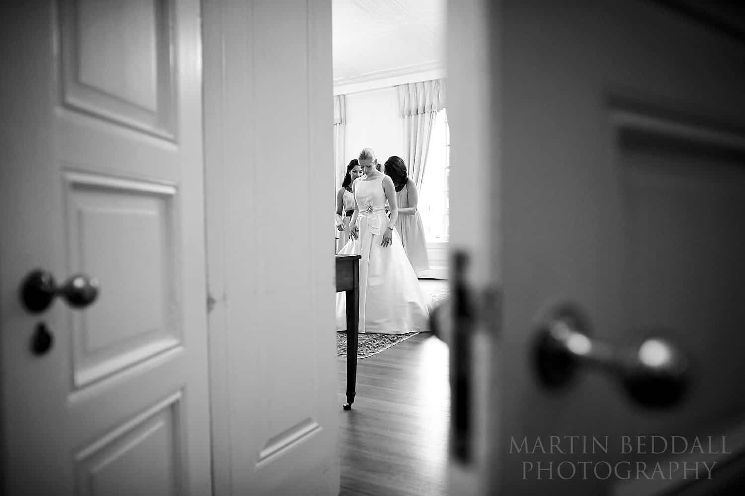 Bride puts on her wedding dress at Inner Temple
