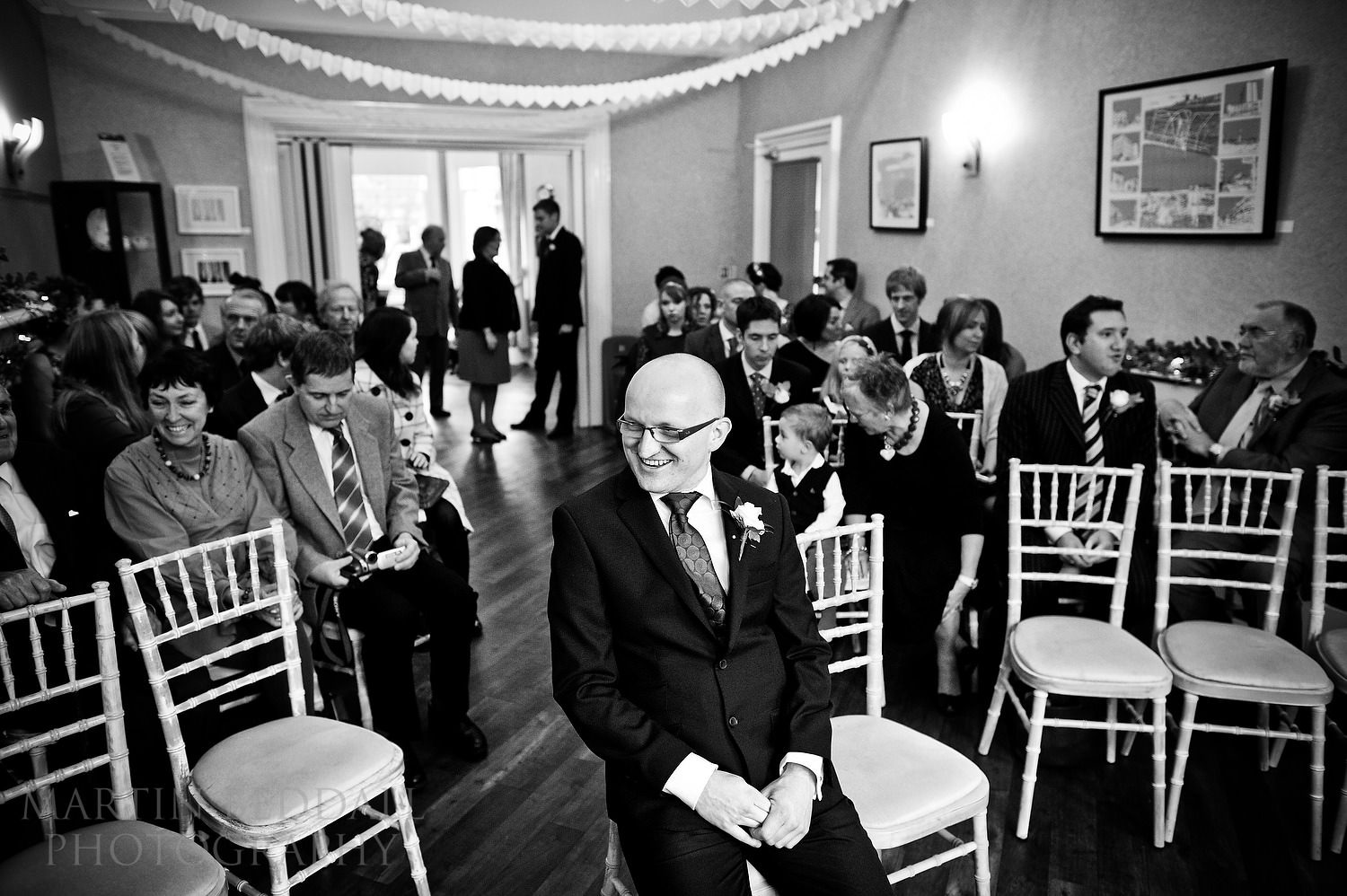 Groom waits in the ceremony room at the Claremont hotel in Hove