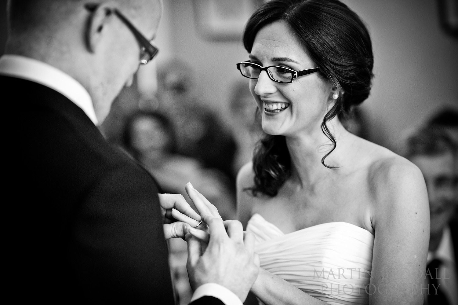 Ring goes onto bride's finger at Hove wedding