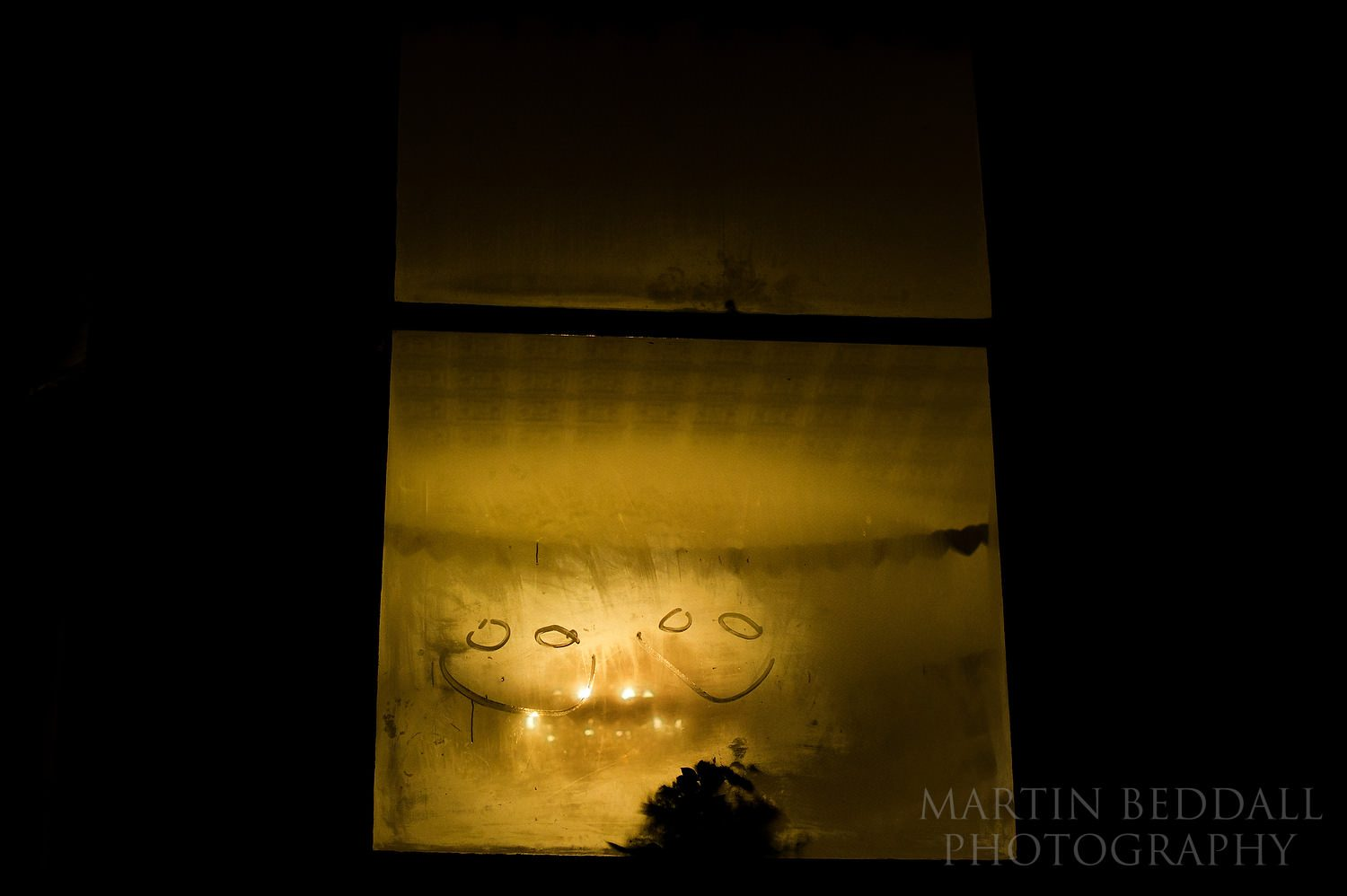 Smiley faces on the steamed up window