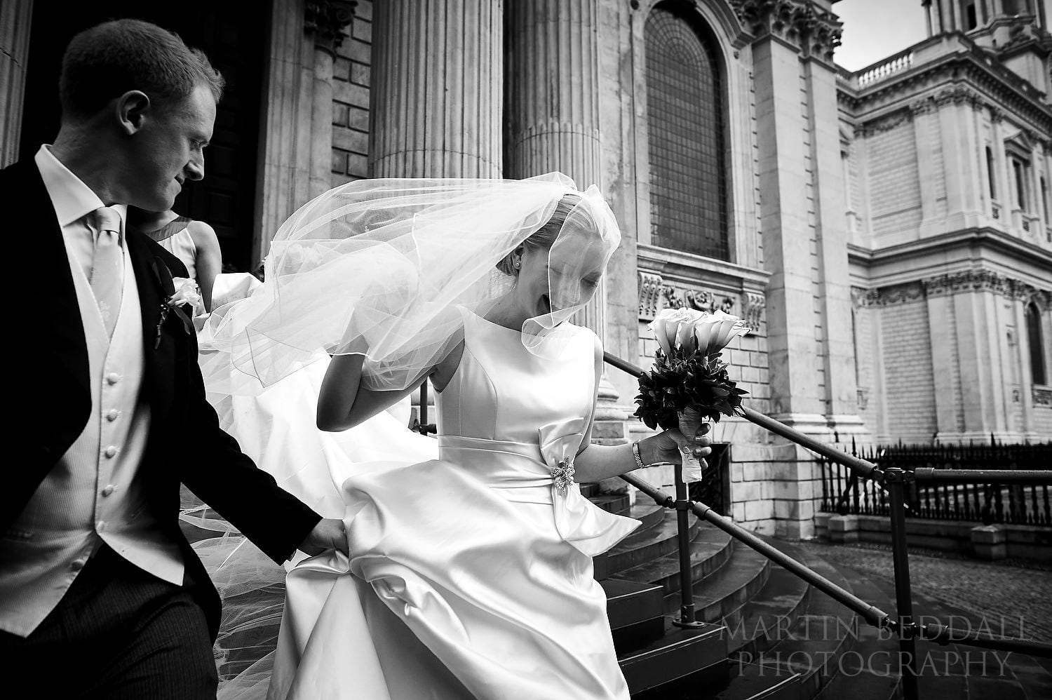 Bride and groom leave St Paul's Cathedral