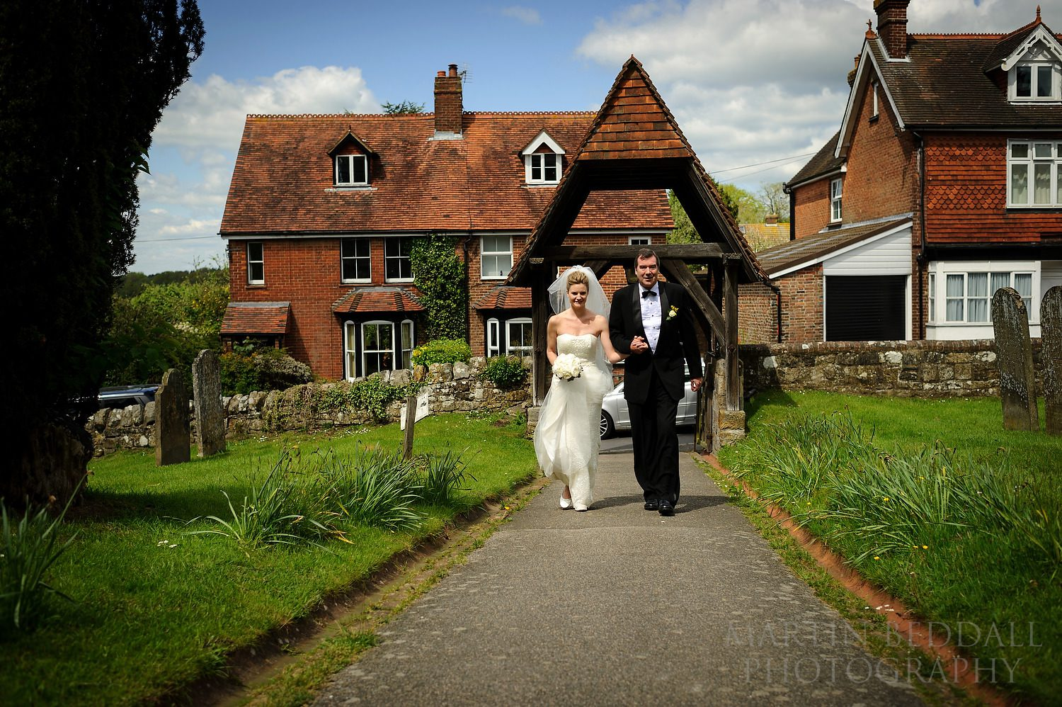 Bride arrives with her father at the church in Rotherfield, East Sussex