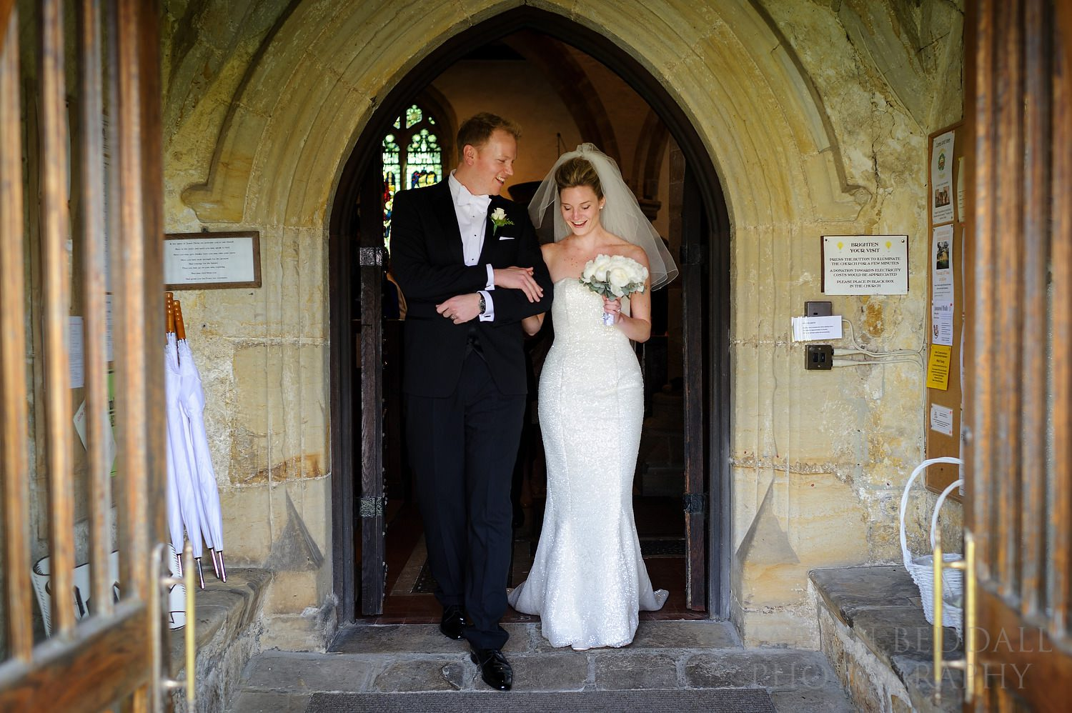 Bride and grookm leave St Denys church