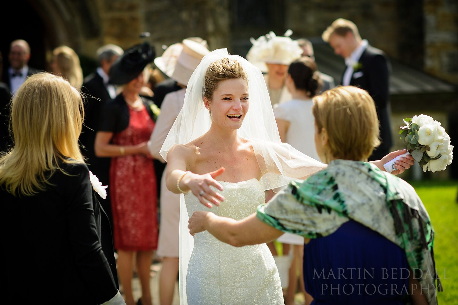 Bride greets friend with open arms