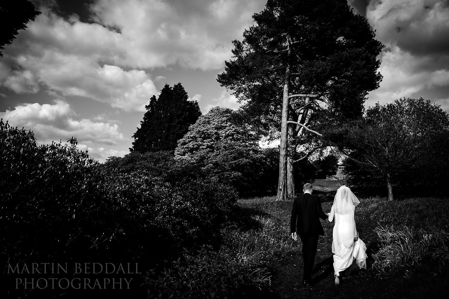 Bride and groom in the grounds of Buckhurst Park