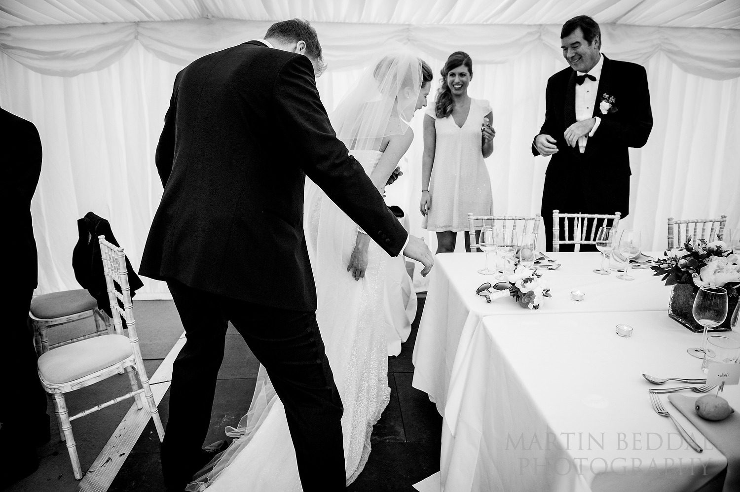 Stepping on the bride's dress