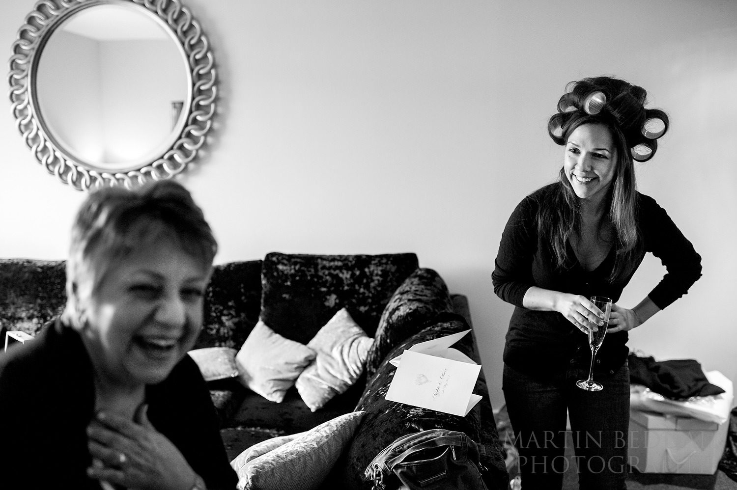 Bride and her mother laughing at getting reday