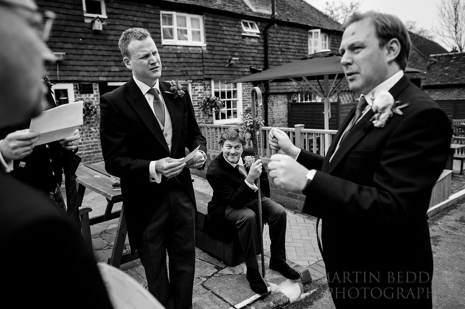 Groom briefs the ushers in the pub car park