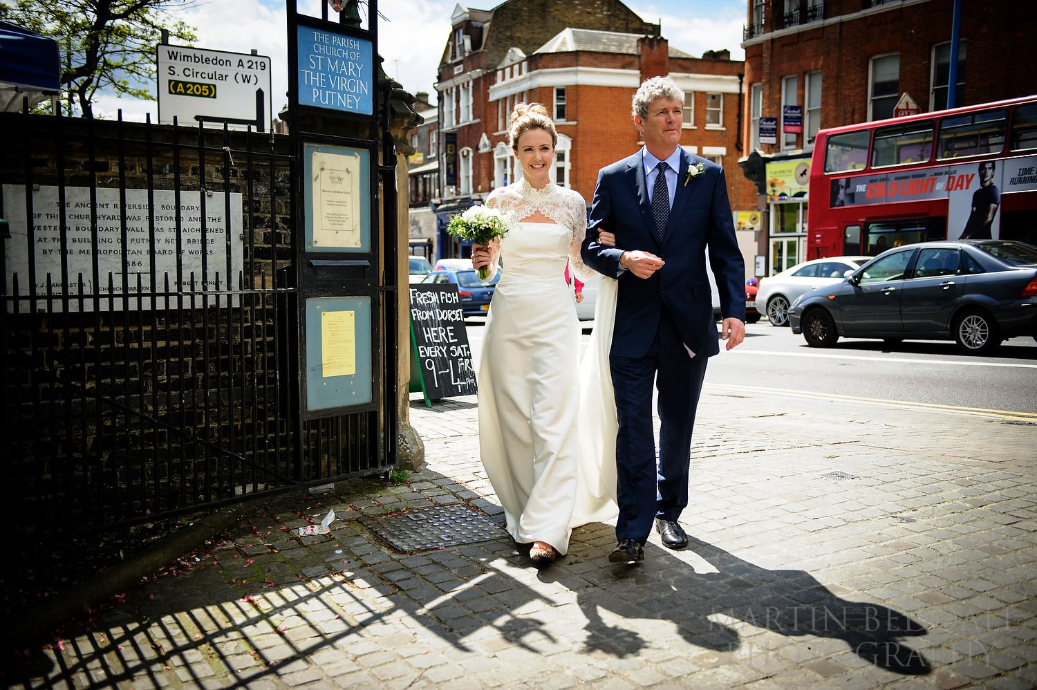 Bride and herfather arrive at St Mary the Virgin church in Putney