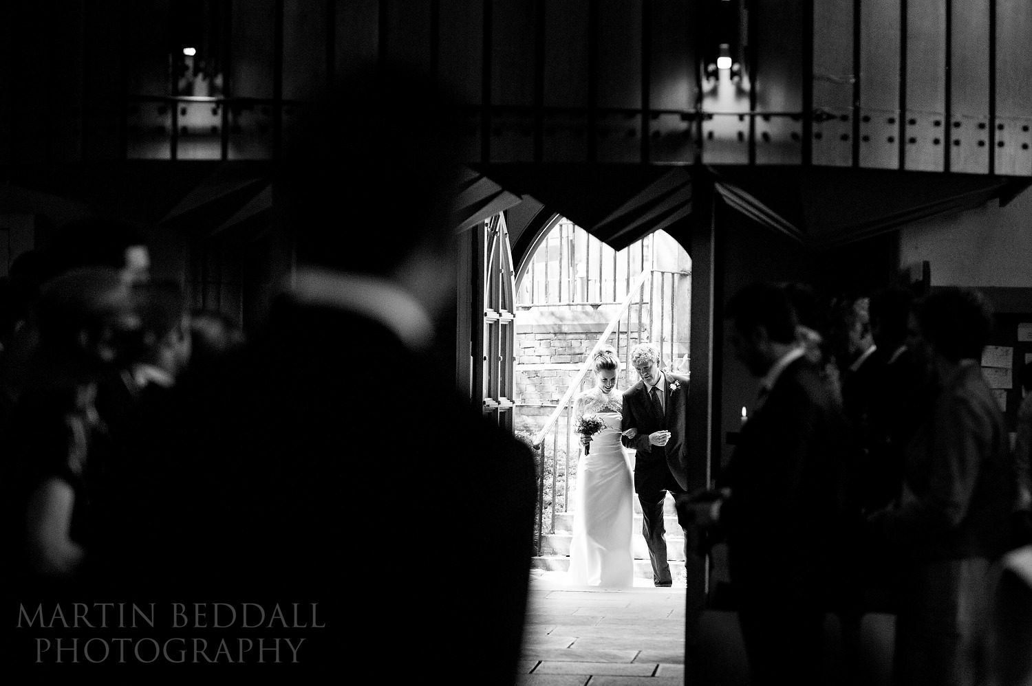 Bride enters St Mary the Virgin church in Putney