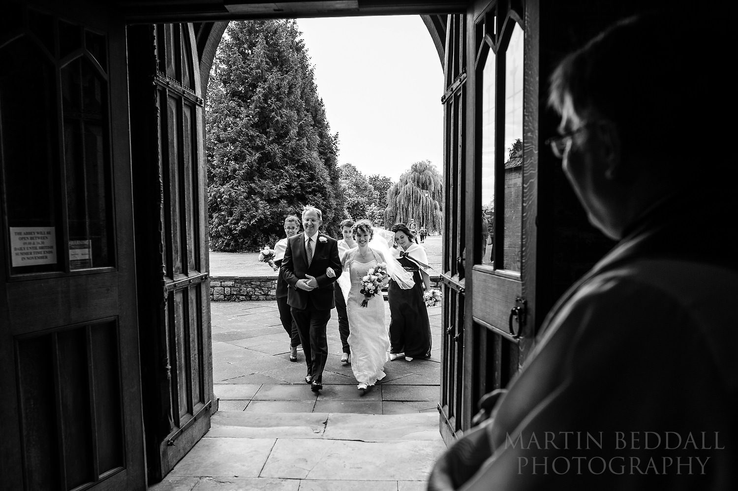 Bride and her father enter Pershore Abbey