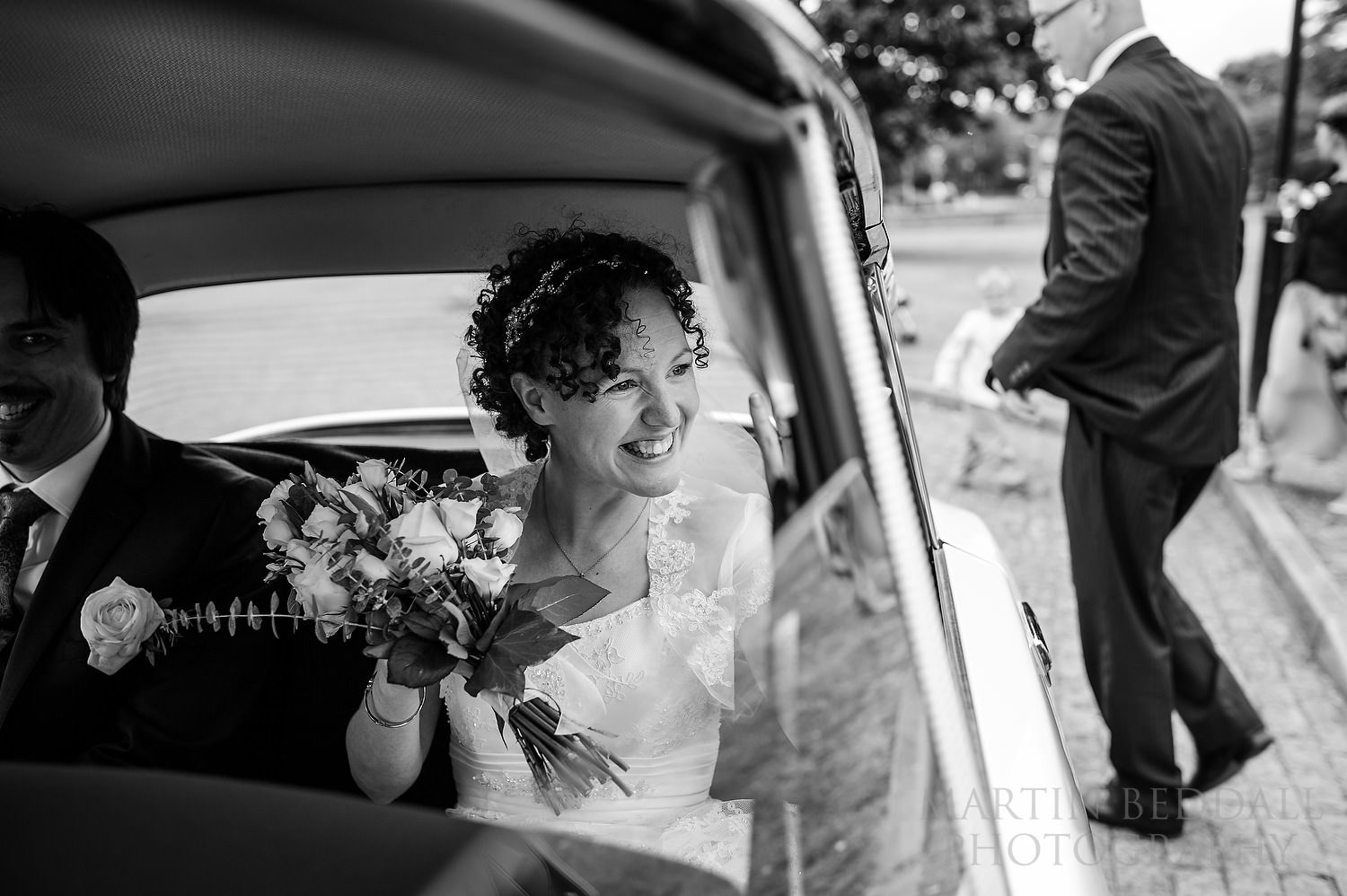 Bride in the French wedding car
