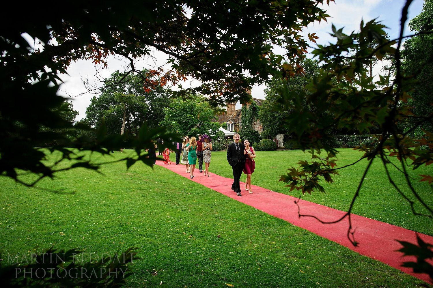 Wedding guests head to the meal at Ridge Farm