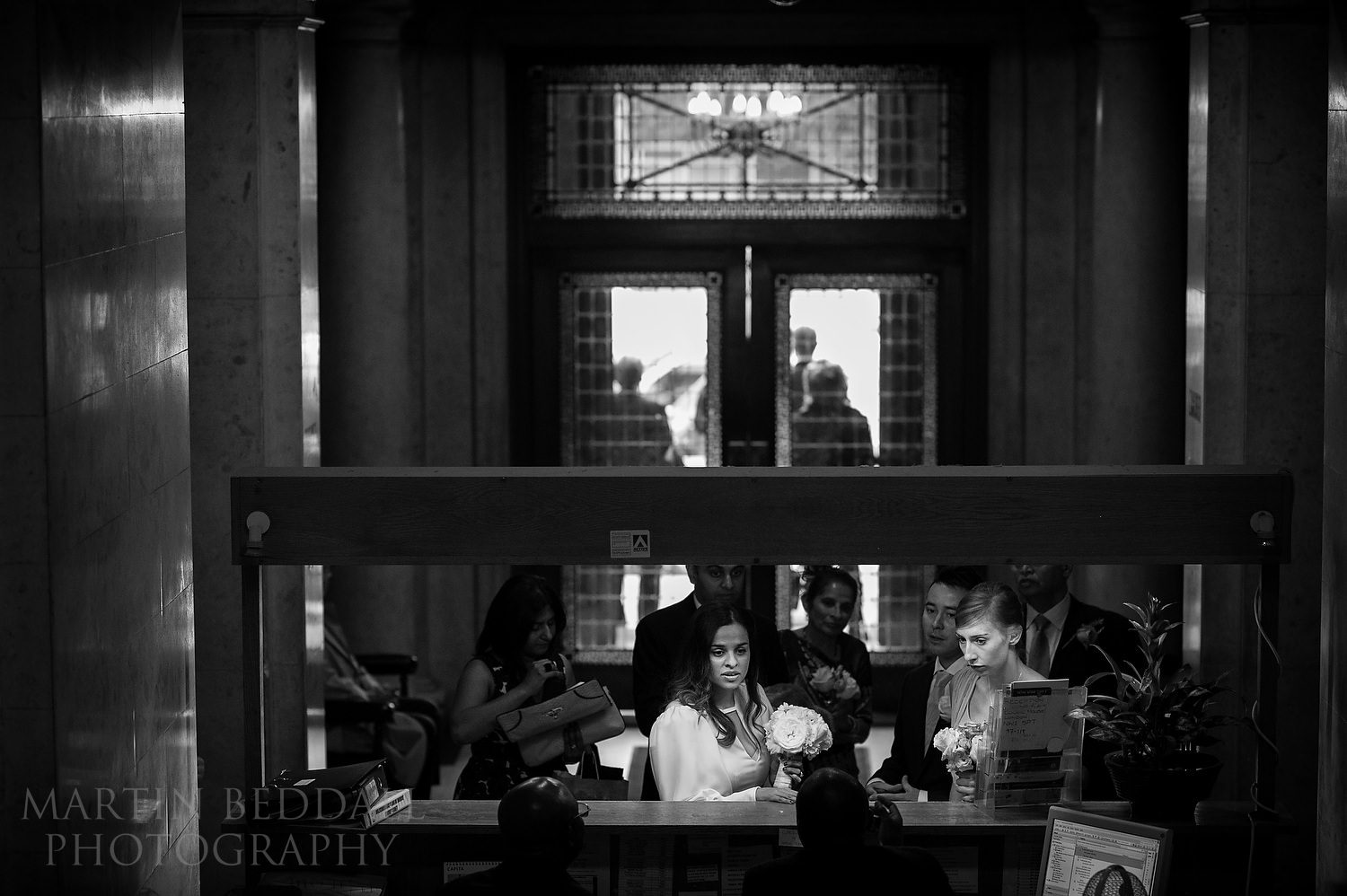 Bride arrives at reception at Old Marylebone Town Hall