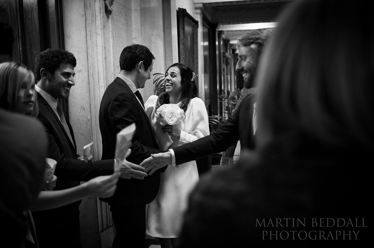 Greeting wedding guests after the wedding ceremony