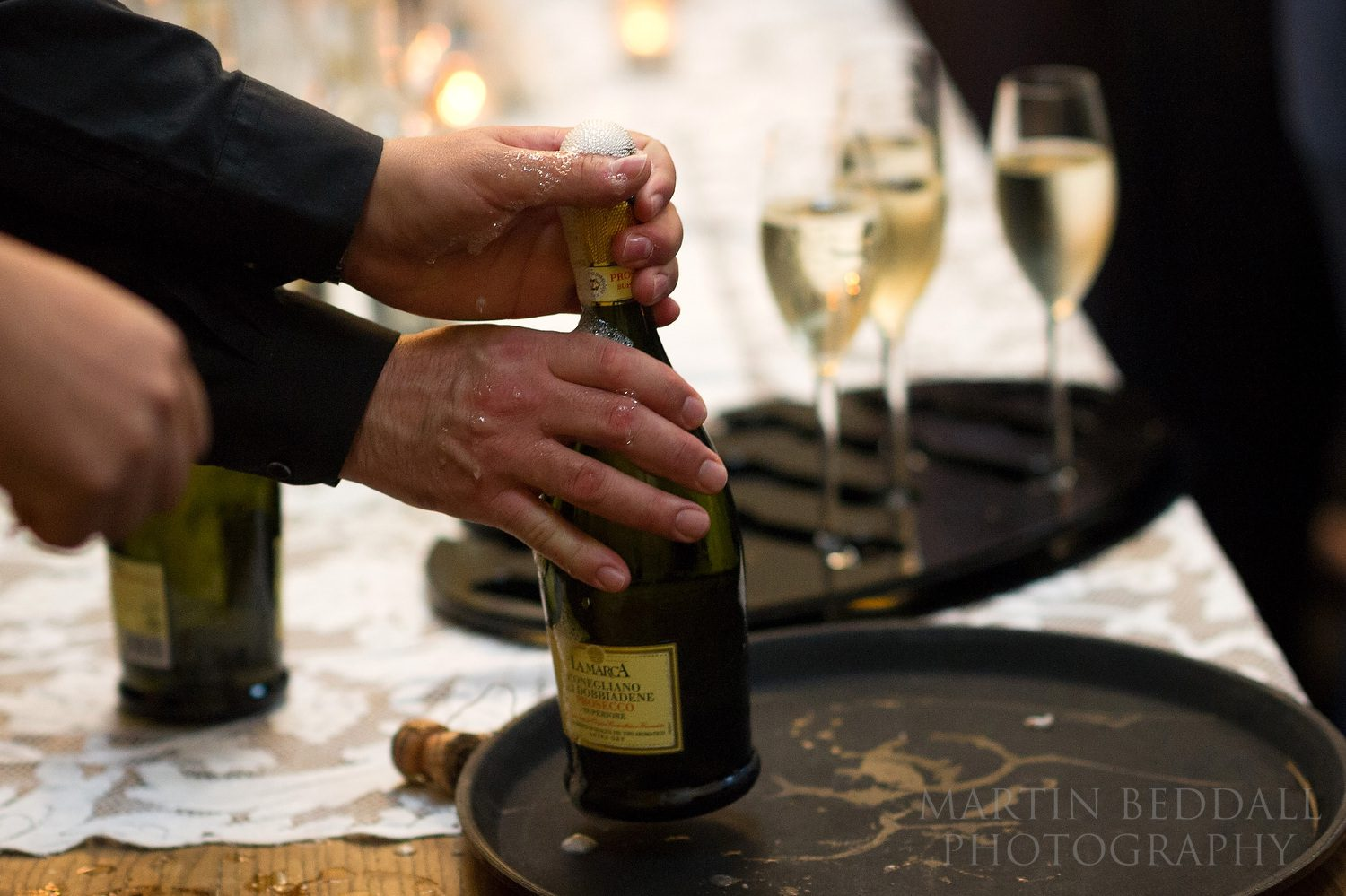 Champagne being opened for the wedding reception