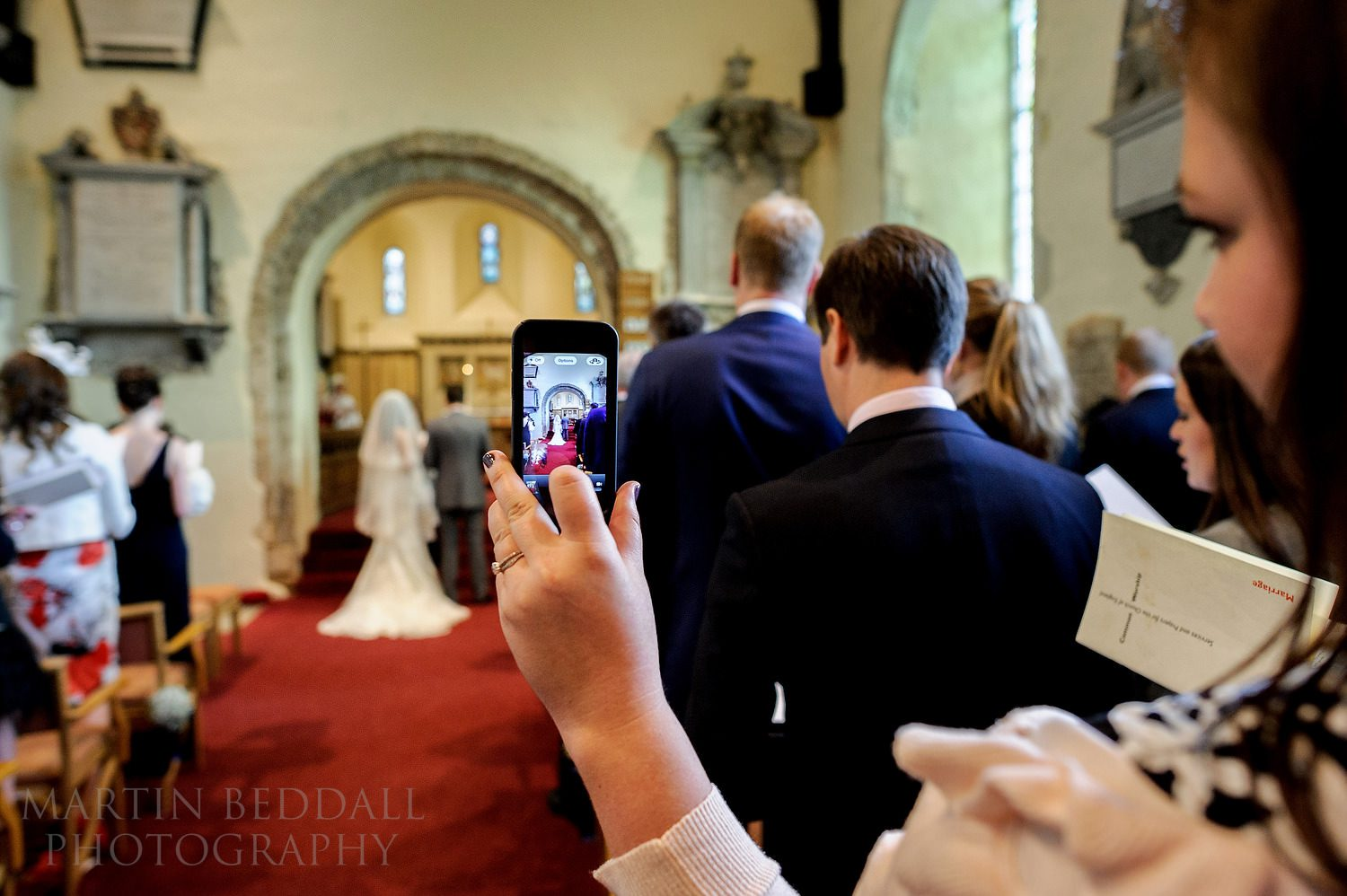 Guest photographing the ceremony