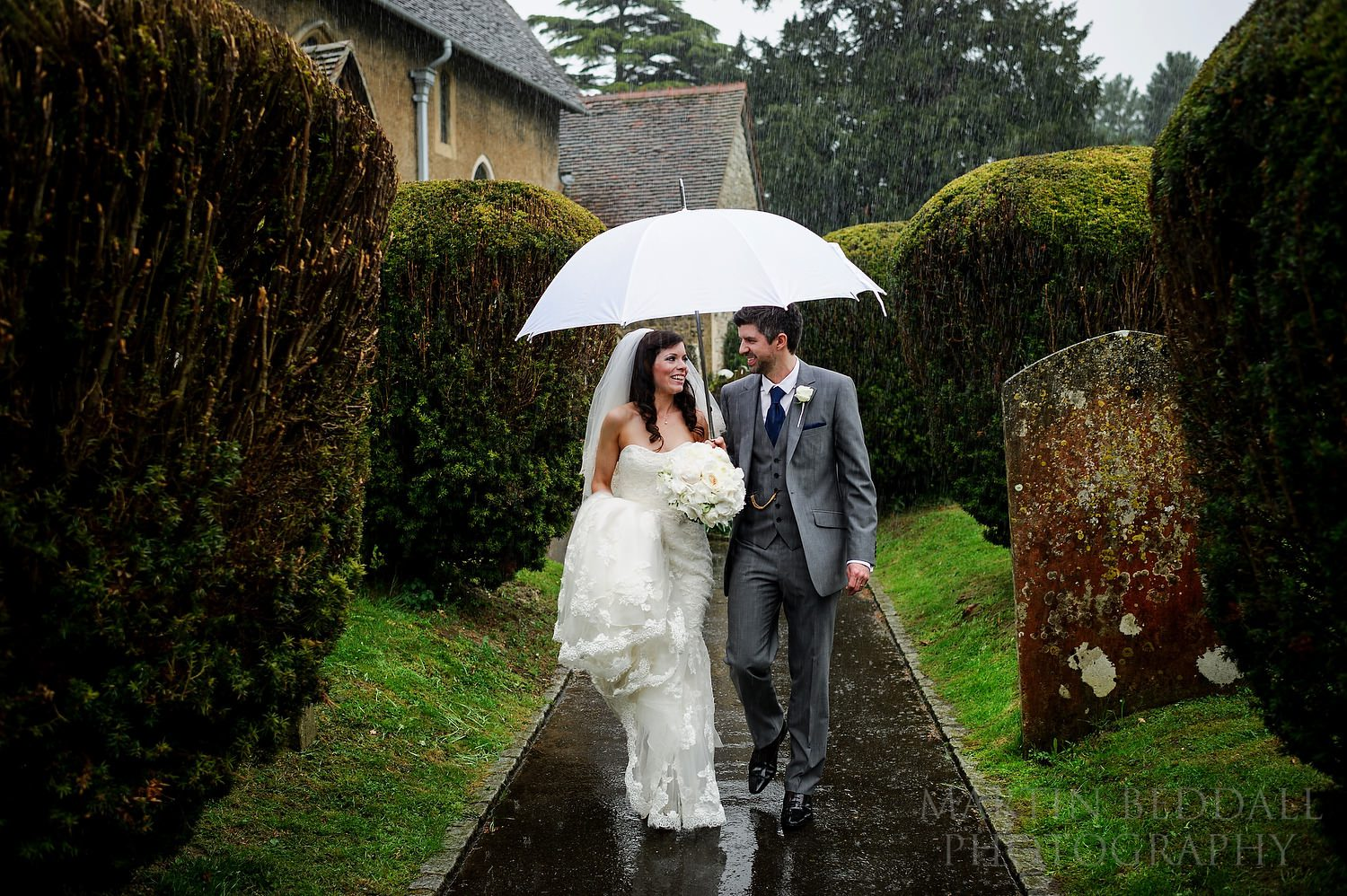 wet wedding - Heavy rain greets the bride and groom