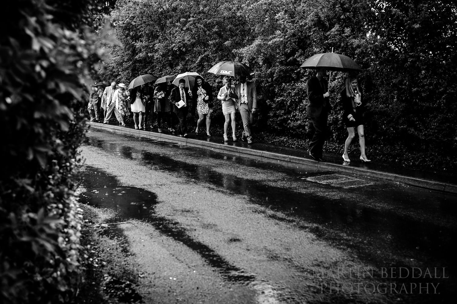 Guests walking in the rain