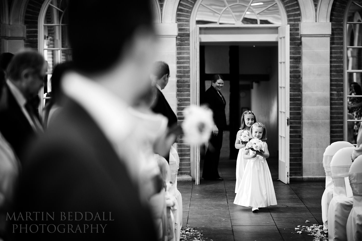 Flower girls start the ceremony at Great Fosters