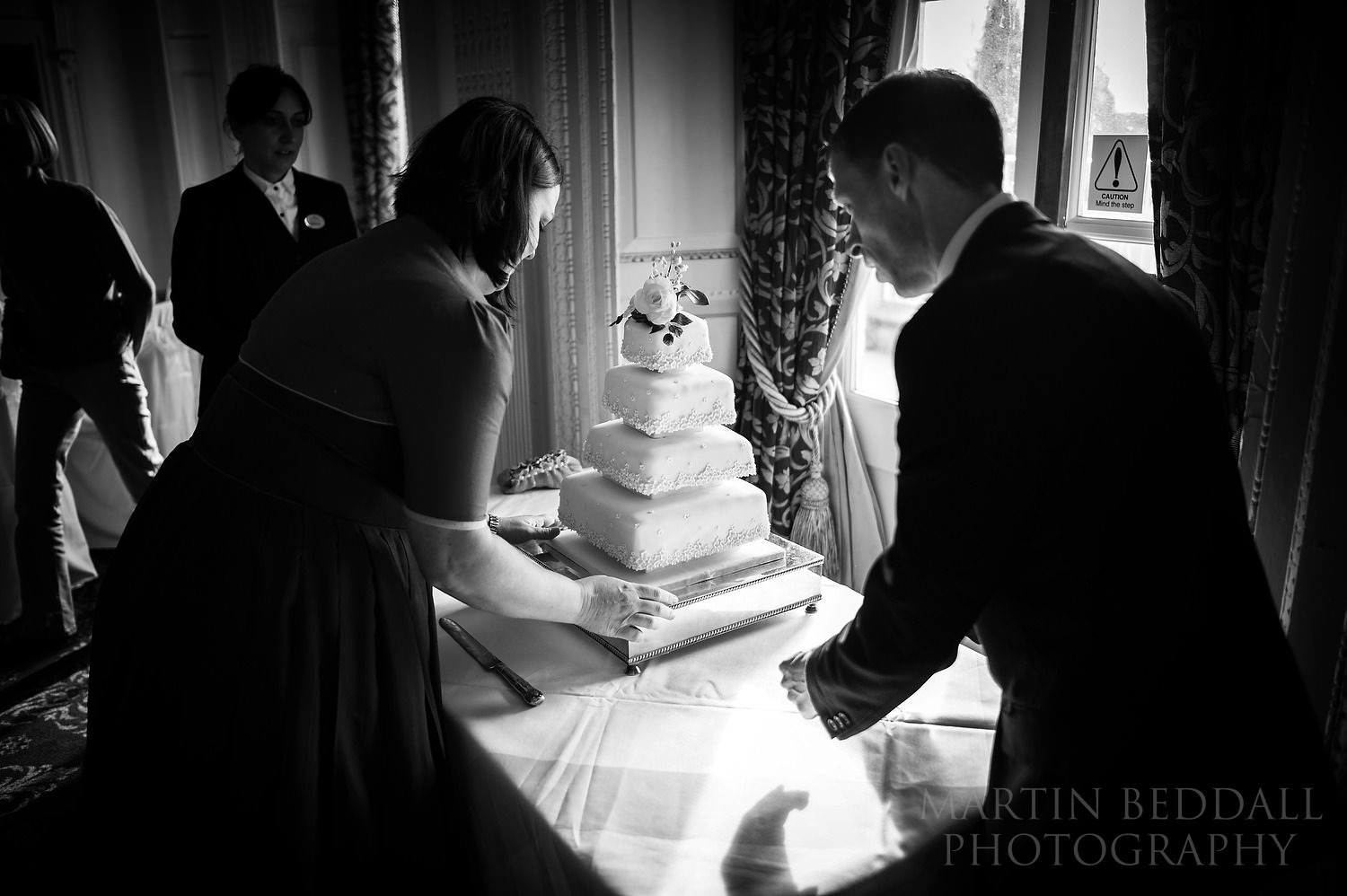 Setting up the wedding cake at Buxted Park wedding