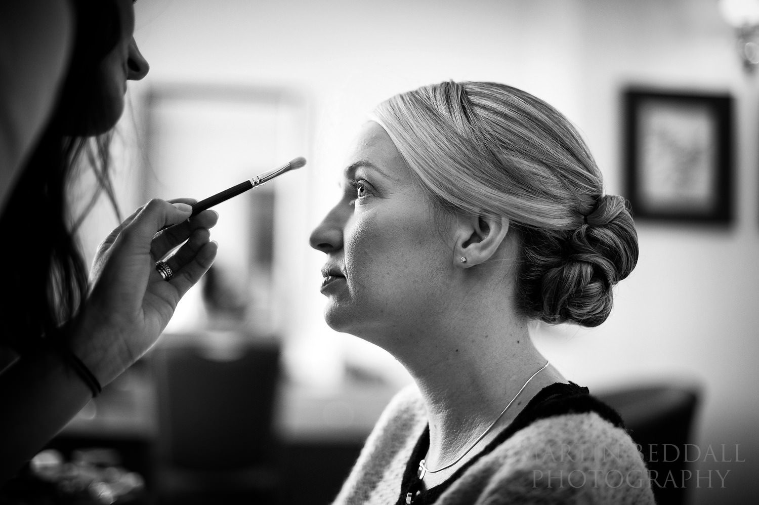 Bride getting ready at Buxted Park wedding