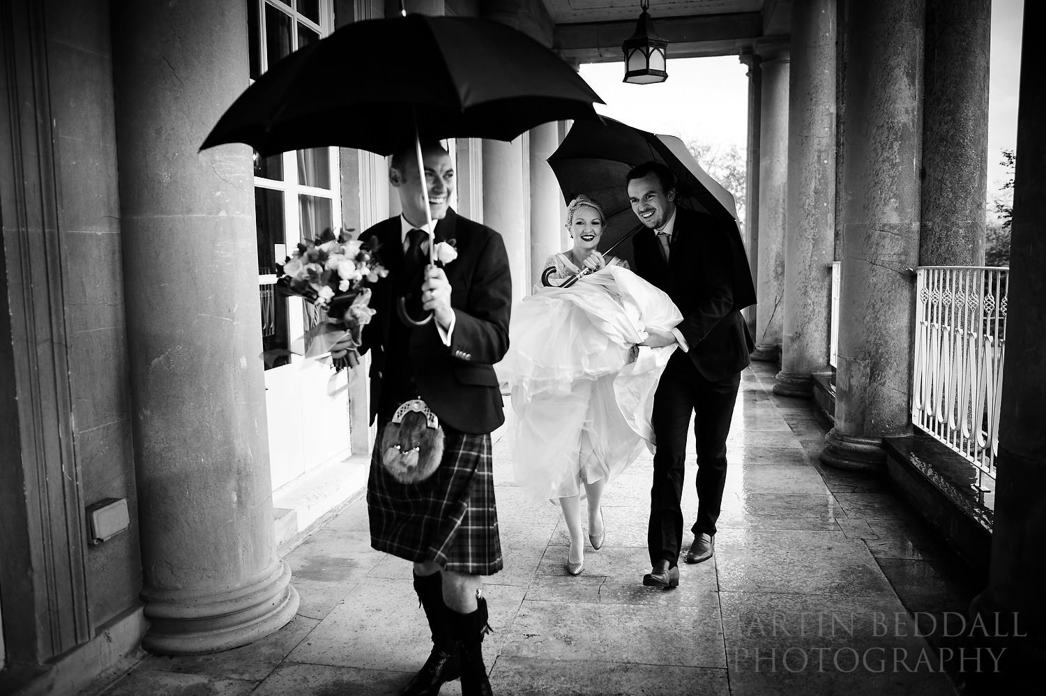 Dodging the rain at Buxted Park wedding