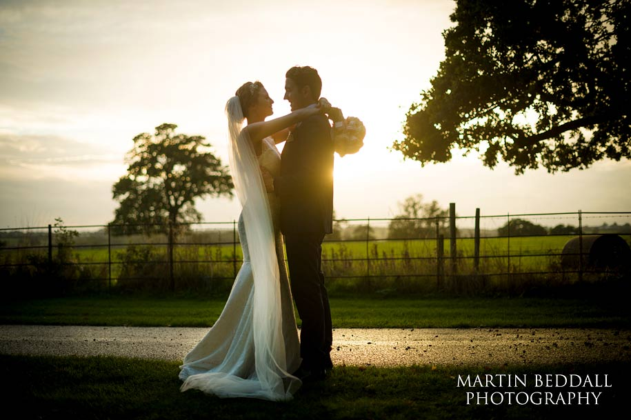 Bride an dgroom embrace is th last of the daylight at Blake Hall