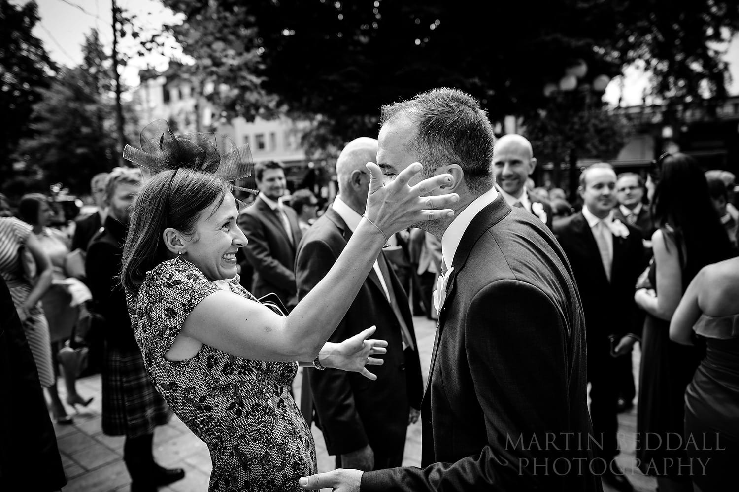 Excited guest greets the groom outside Islington Town Hall