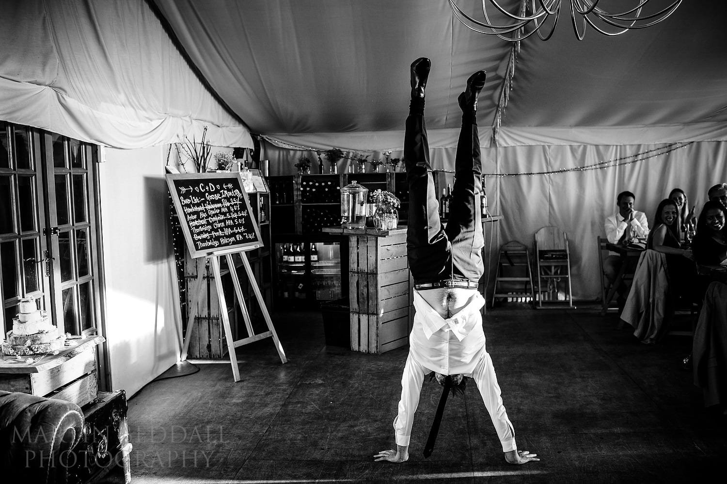 Groom does a handstand