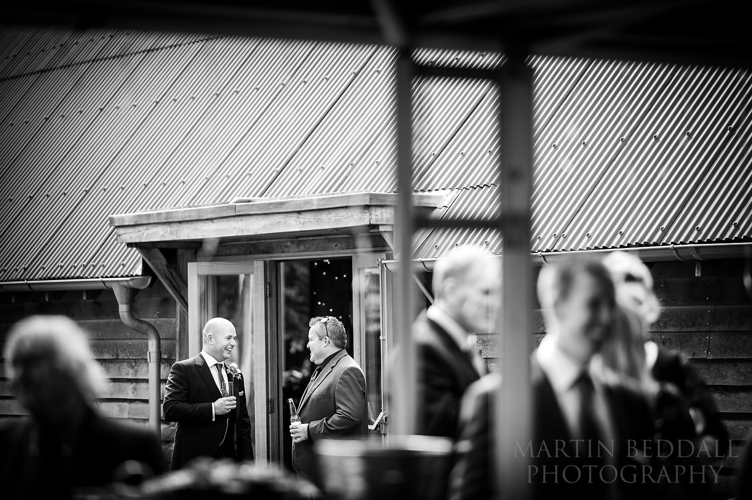 Groom laughing at Southend Barns wedding reception