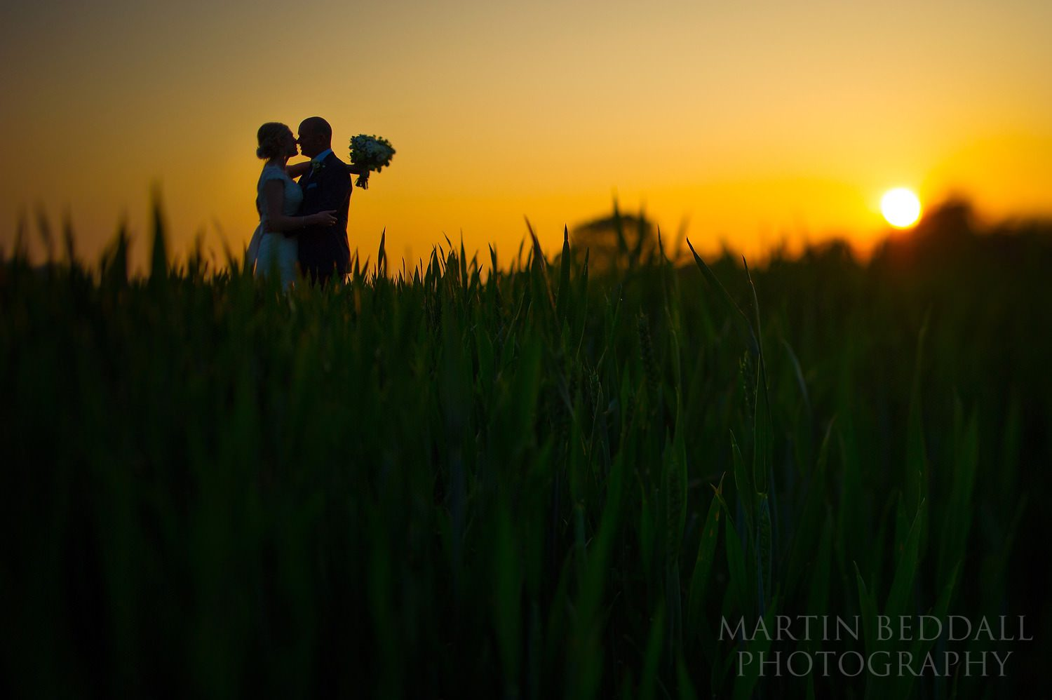 Couple portrait at Southend Barns at sunset