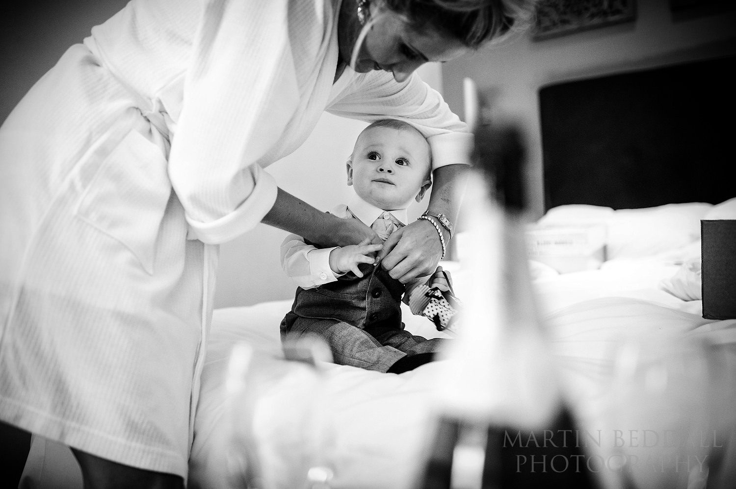 BRide dresses her son in his wedding outfit