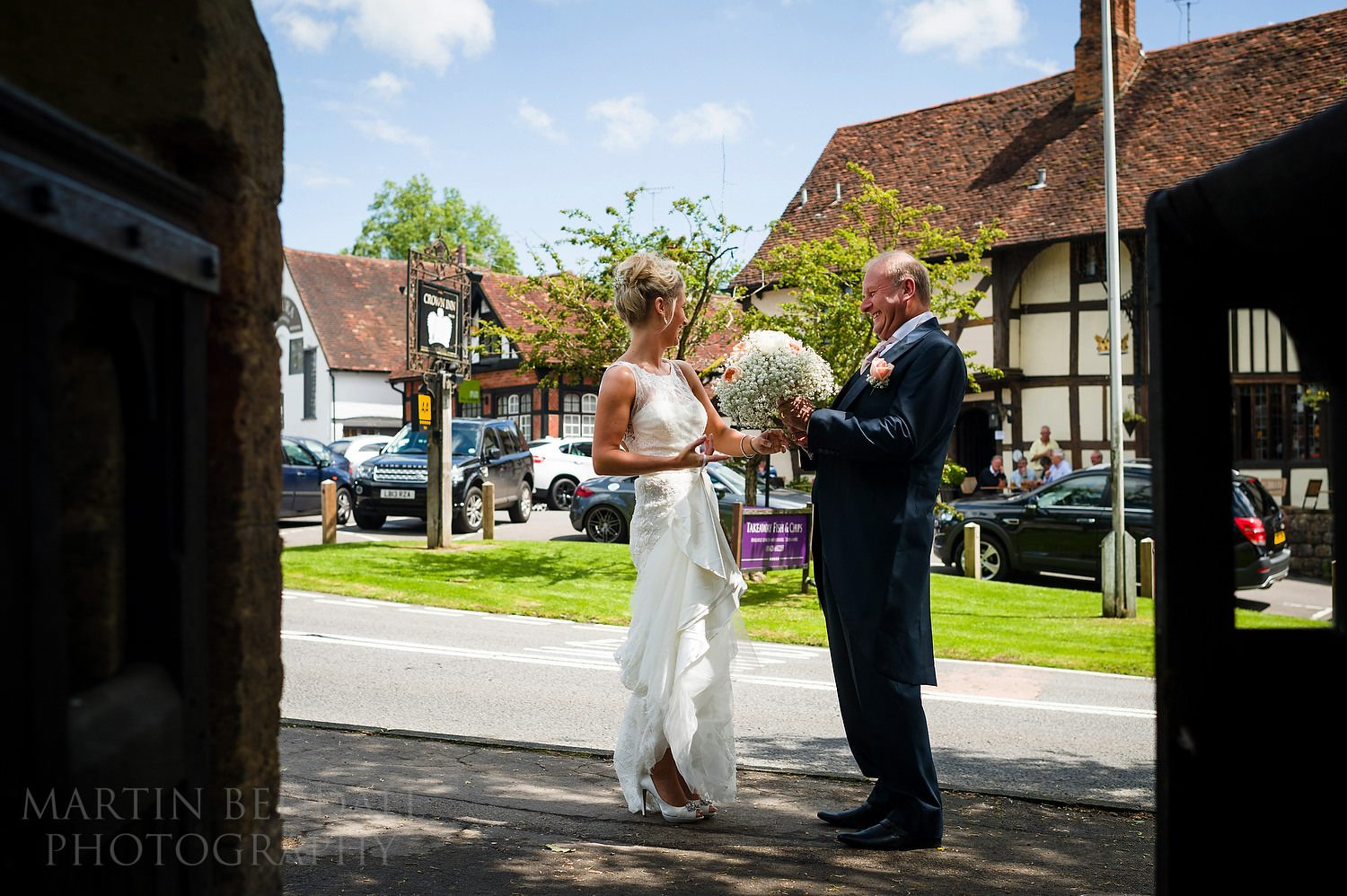 Bride and father banter with pub drinkers