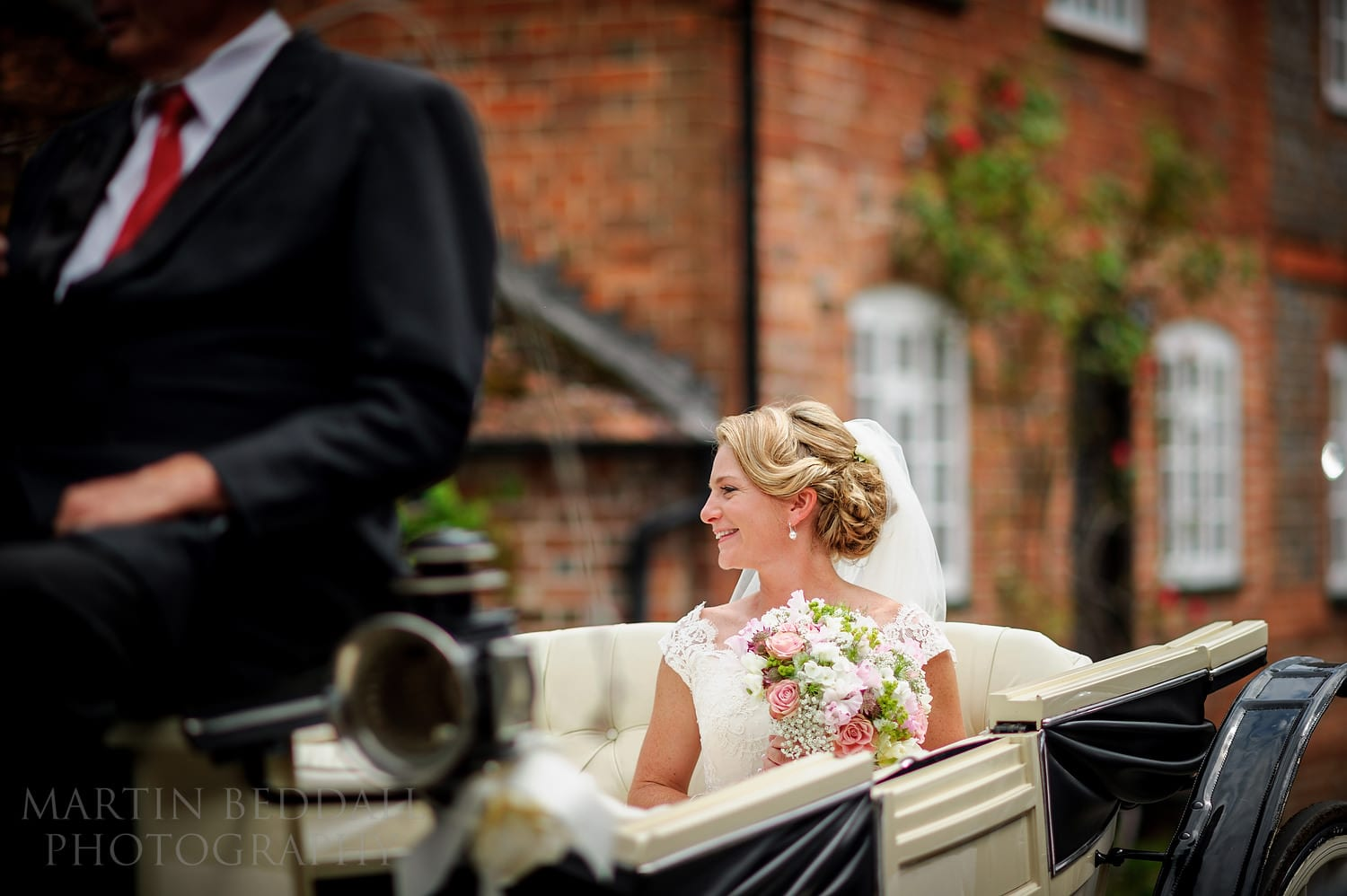 Bride arrives the church by horse and carriage