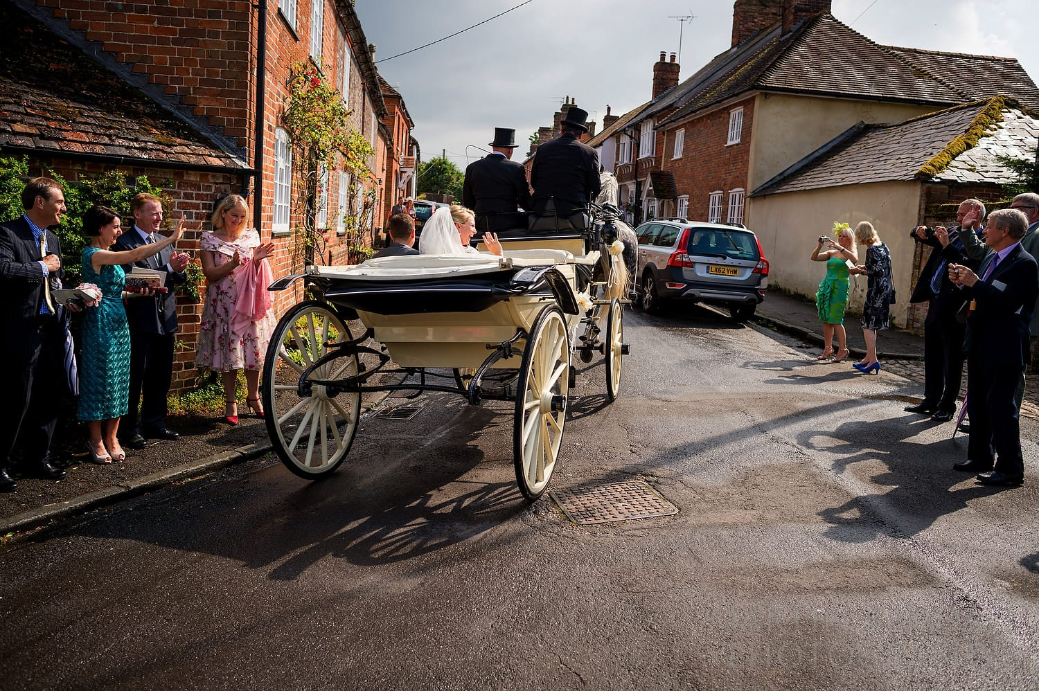 Bride and groom leave the church in the horsedrawn carriage
