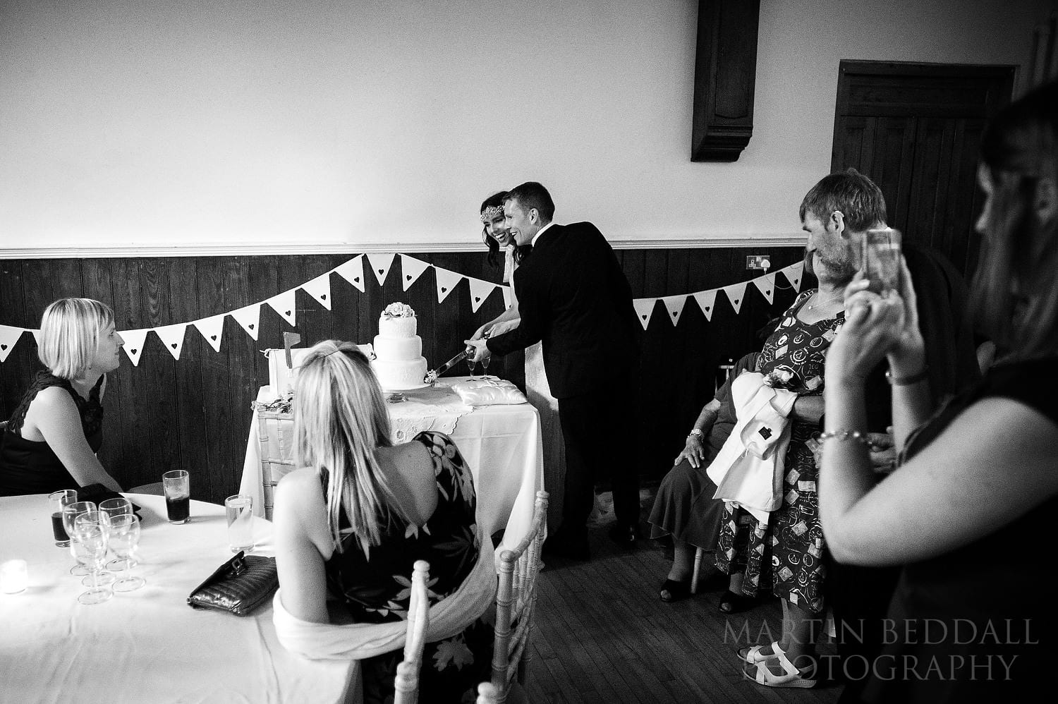 Cutting the wedding cake at Queen's Hall wedding