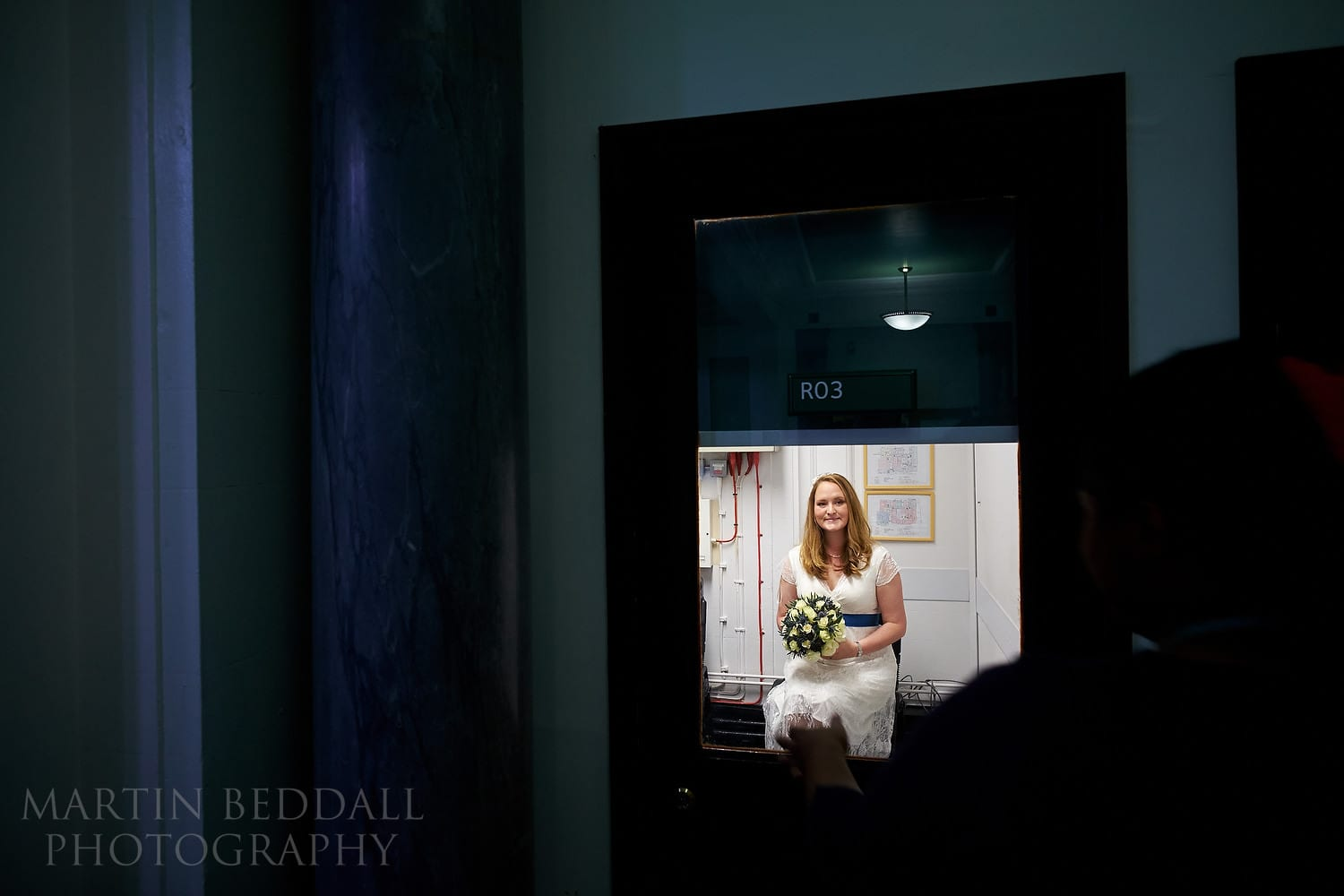 Bride waits for her interview with the registrars