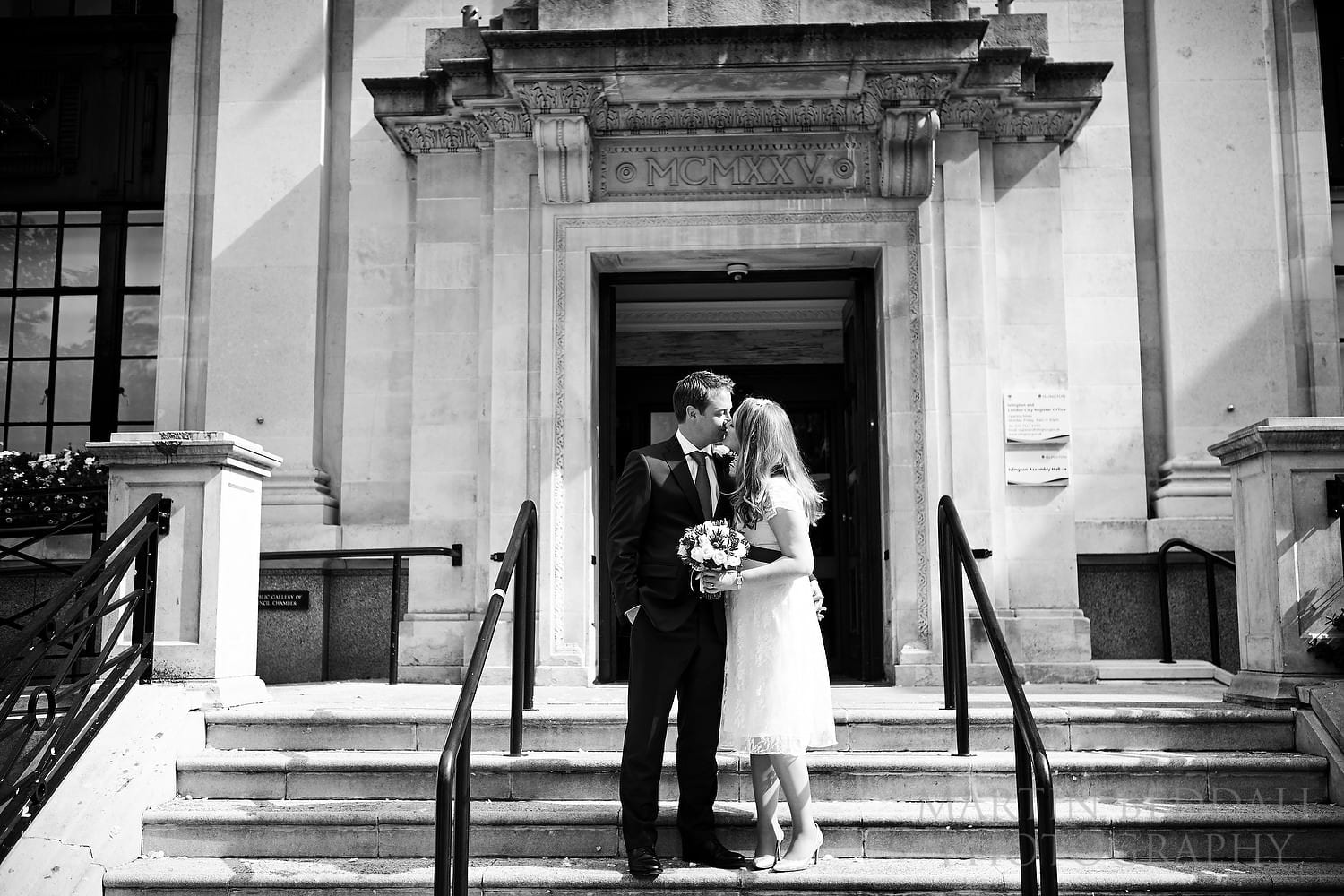 Couple kiss on the steps of Islington Town Hall