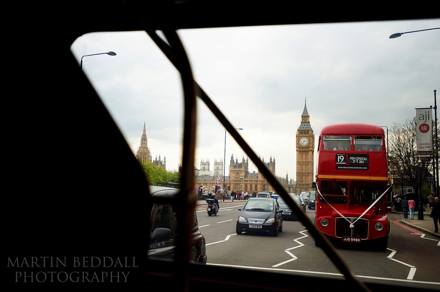 Wedding Routemasters buses on Westminster bridge