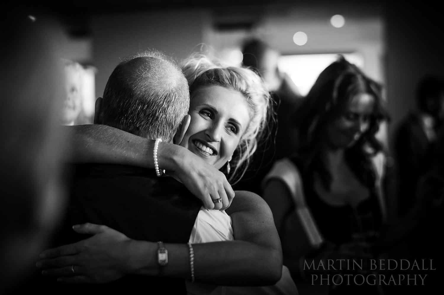 Bride hugs her father on the dance floor at Russets