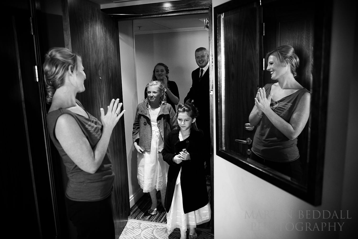 Bride greeting family to the hotel room