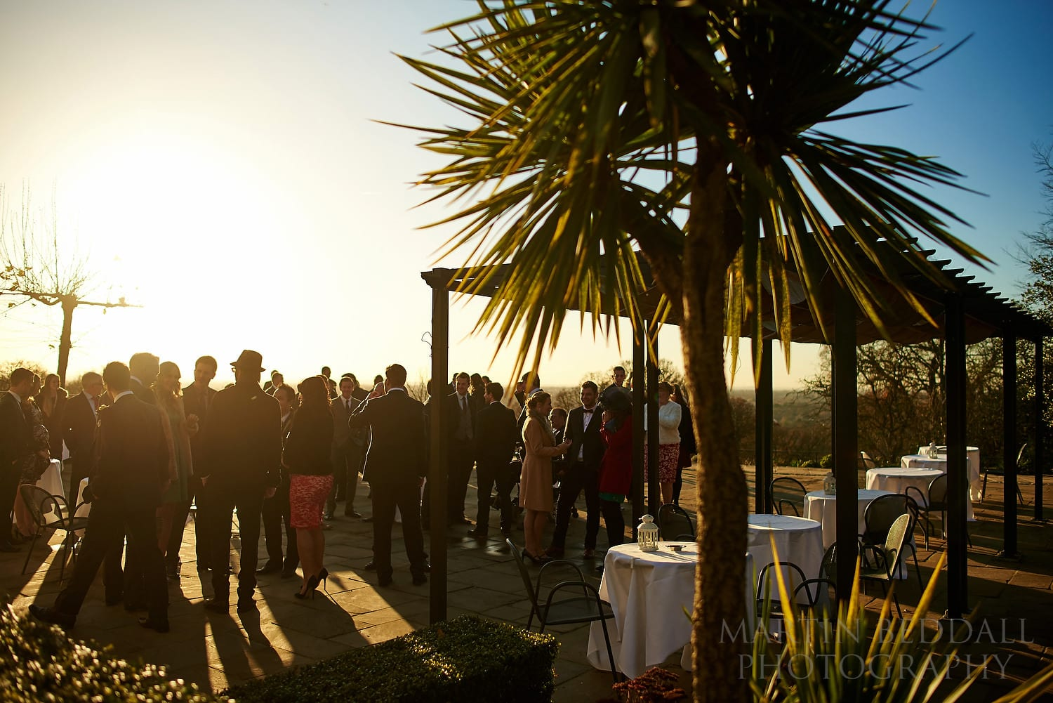 Wedding guests on the terrace at a winter wedding at Pembroke Lodge