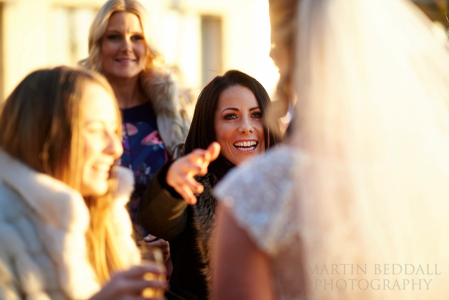 Guests greet the bride