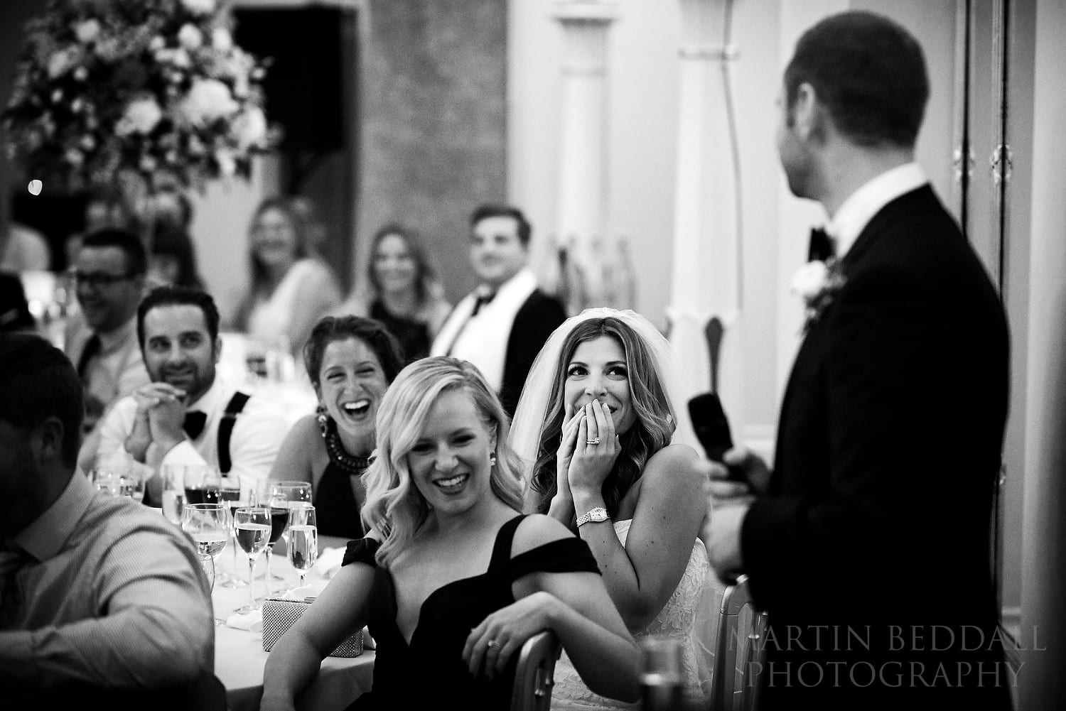 Bride reacts to the groom's speech at Lansdowne Club wedding