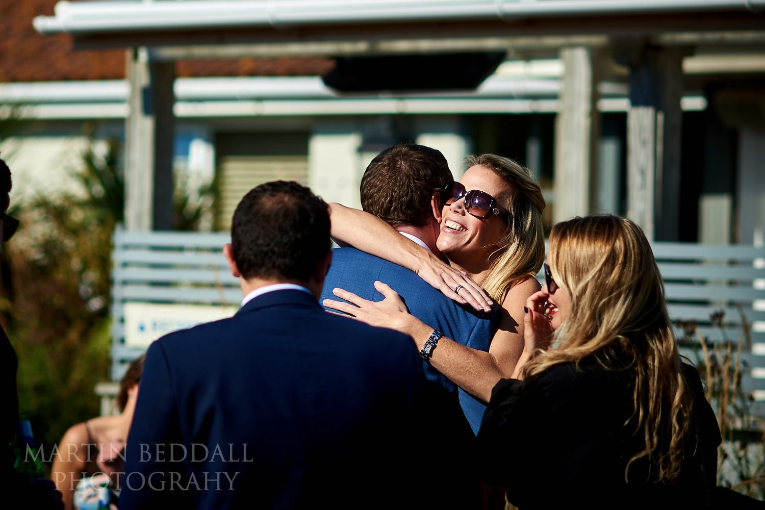 Hug for the groom from a guest