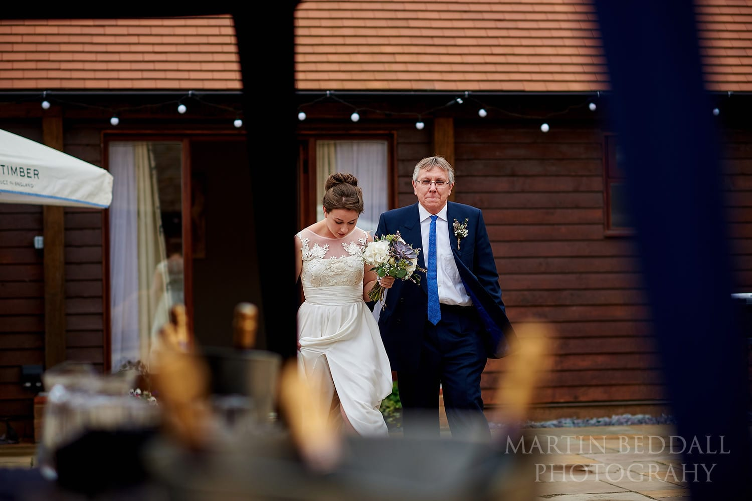 Bride heads to the ceremony at Long Furlong Barn wedding