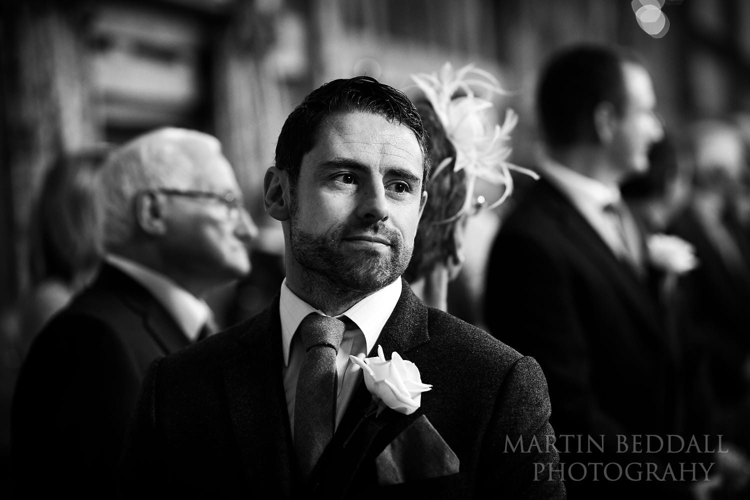Groom waits at the end of the aisle