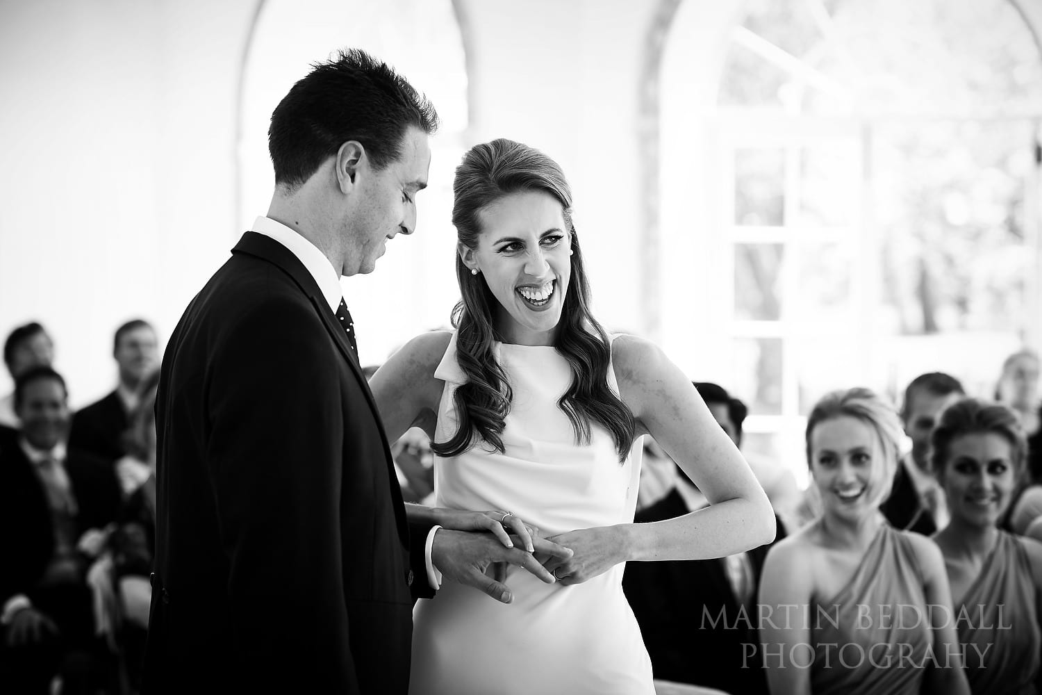 Getting the ring onto the groom's finger