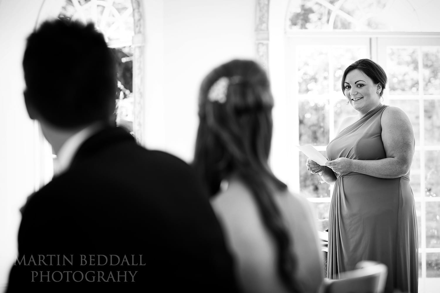 Reading by a friend at Northbrook Park wedding ceremony